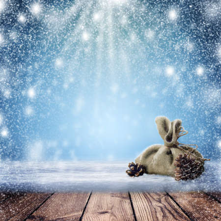 Christmas Holiday Background, Christmas table background and blizzard. Christmas night. New Year Frame for your text. Winter nature background. A bag with gifts and pine cones in the snow. Zdjęcie Seryjne