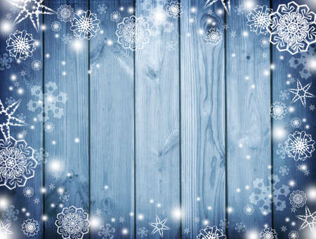 Blue christmas background. New Year Frame for your text. Winter Snowy Plank With Wintry Background. blue wooden snowy background.top view.Christmas night and snowfall. Zdjęcie Seryjne