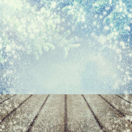 Wooden table and Christmas trees in the snow. Snowstorm Nature background. Winter Christmas New Year background.