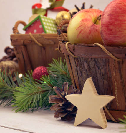 Wooden Christmas star and festive decor. Close-up. Christmas New Year. Festive decor in a rustic style.