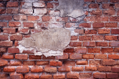collapsing: Collapsing stone wall of an old house with brick masonry