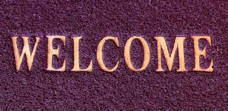 welcome door: Photo of a welcome door mat isolated