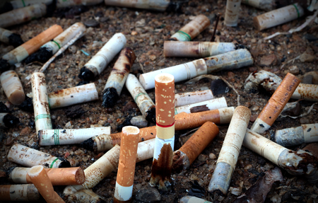 noxious: cigarettes butts Ashtray background Stock Photo