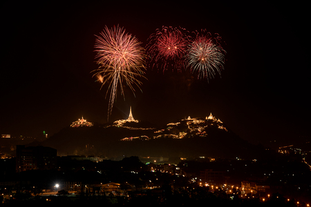 the celebrities: Celebrities firework with ancient pagodas on mountain in night sky Stock Photo