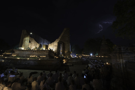 ceremonial: Thunderbolt during ceremonial enlightenment departure of the Buddha around ancient church on Visakha day, Ayuthaya province, Thailand, June 1st, 2015