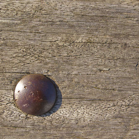 A natural brown wood texture with nail Stock Photo
