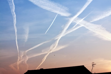 Airplane traces on the sky Stock Photo
