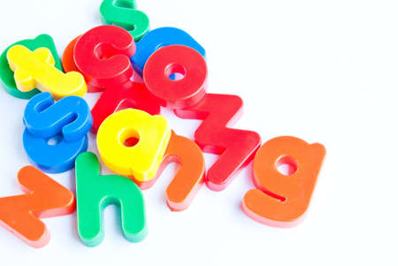 Plastic letters on white background photo