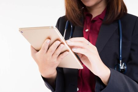 businesswoman suit: close up asian doctor using tablet on white background