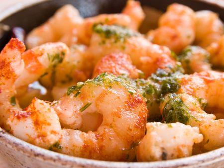 Bowl of fresh prawns cooked in garlic.