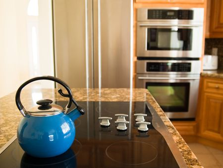 electric tea kettle: Bright Blue Traditional Whistling Kettle in Modern American Kitchen.