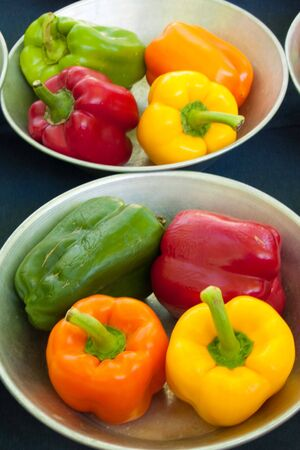 Fresh Peppers in steel bowls Stock Photo