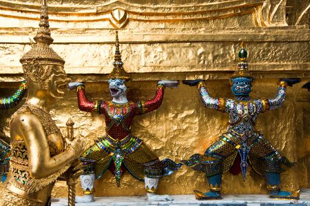 Thai statue and architectural detail at the Temple of the Emerald Buddha, Bangkok, Thailand. Stock Photo