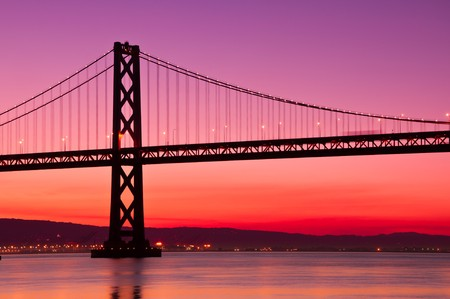 The Bay Bridge in San Francisco silhouetted against a clear sky just before sunrise. Stock Photo - 7714673
