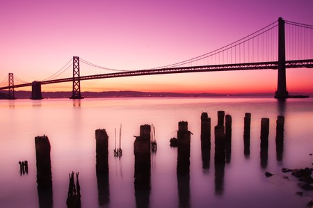 The Bay Bridge in San Francisco silhouetted against a clear sky just before sunrise. Stock Photo - 7714672