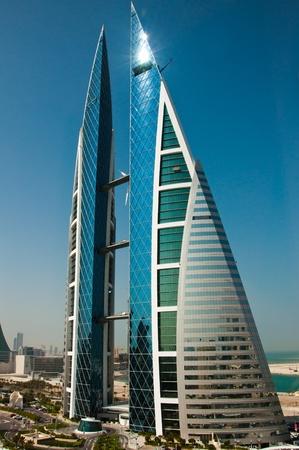 bright center: The World Trade Centre, Bahrain, in bright sunshine and blue sky. Stock Photo