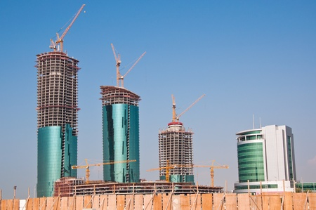 reclaimed: Modern buildings being built on reclaimed land in the Gulf State of Bahrain, Middle East.