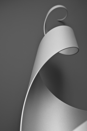 Steel cylinder cut and formed into an abstract sculpture  Stock Photo