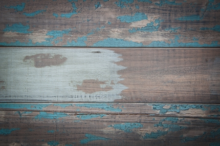 Aged wooden boards with some blue flaking paint giving an antique look and texture  Stock Photo