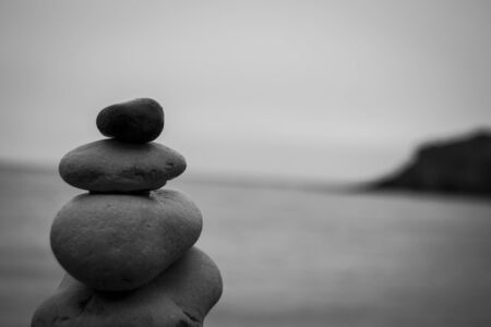 soul searching: Pebbles by the sea in perfect balance