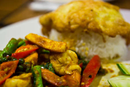 the spicy shrimp omelet and rice thai food photo