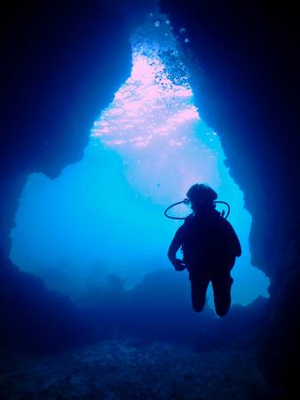 cave exploring: Scuba diver exploring an underwater cave Stock Photo