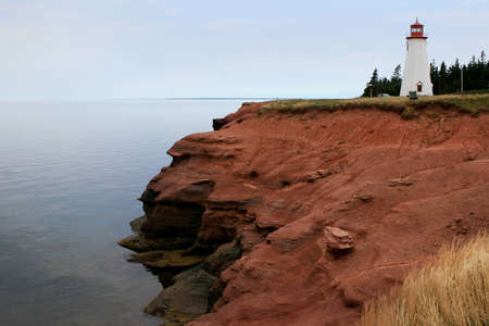 red bluff: A  lighthouse on the red bluff,Prince Edward Island