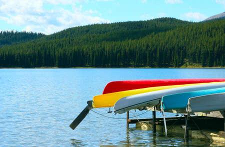 Colourful canoes on dock,maligne lake,jasper,Alberta,Canada photo