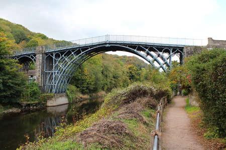 ENGLAND; IRONBRIDGE, OCTOBER 14, 2015: The world's first cast-iron bridge crosses the River Severn in Ironbridge. Editorial