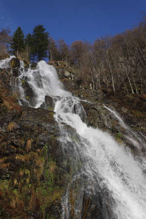 The water of the creek Stübenbach plunges down the Todnau Waterfall