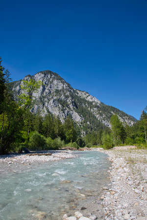 On the banks of the creek Johnsbach in the Gesäuse National Park in Austria Standard-Bild
