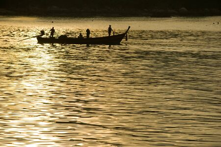 Thai fishermen are out fishing in the morning.Phuket,Thailand photo