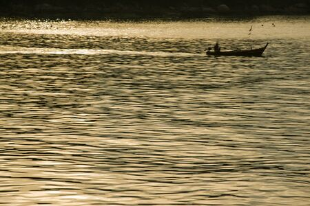 Thai fishermen are out fishing in the morning.Phuket photo