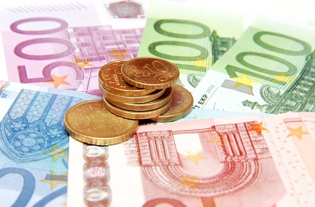 Euro banknotes and coins photo