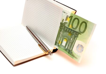 Notebook, money and pen photo