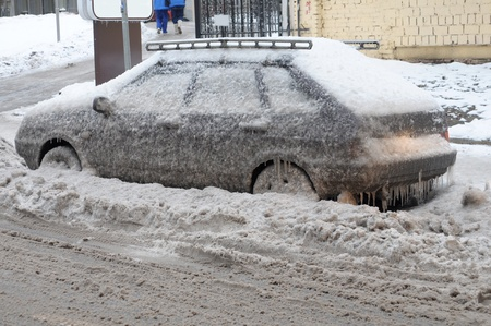 anomalies: MOSCOW RUSSIA - DECEMBER 27:  Weather anomalies covered all the transport in ice skin on December 27, 2010 in Moscow, Russia.