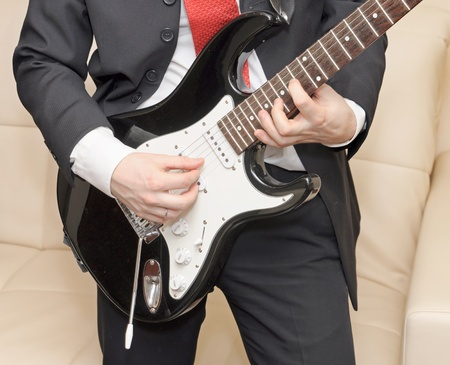 Businessman playing guitar photo