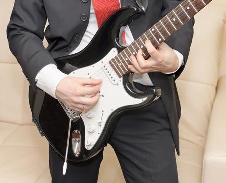 heavy metal music: Businessman playing guitar
