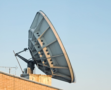 Big antenna on a roof photo