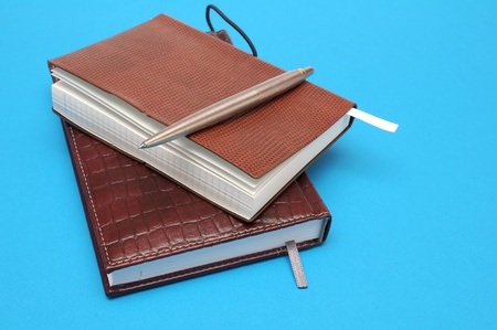 Notebooks on blue background photo