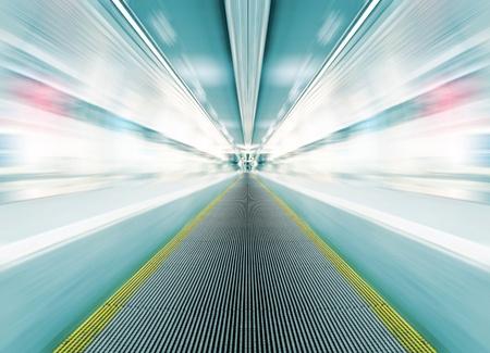 blur subway: metro escalator in glass corridor Stock Photo