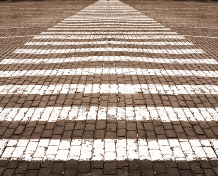 White lines of road marking on stone blocks road Stock Photo - 11371566