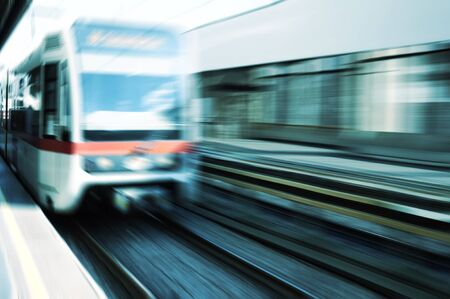 rapid steel: Moving train on platform Stock Photo