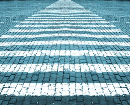 White lines of road marking on stone blocks road. Blue tint  Stock Photo - 11372387
