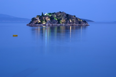 Island with church in a sea. Evening. Stock Photo - 11371826