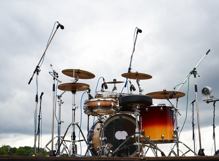 drum kit: Drums on a stage in a park