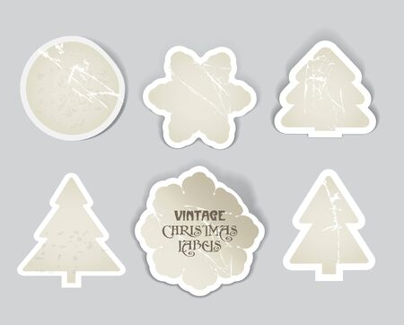 Vector scratched vintage christmas style labels set. Paper pines, circle and snowflakes Vector