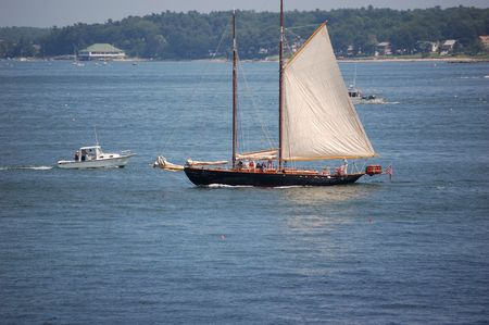 schooner: old schooner sailing in harbor