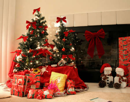 christmas trees in front of a fireplace