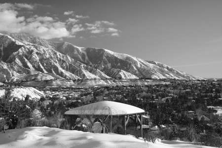mountain range with snow in black and white